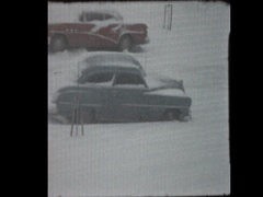 50's antique cars in snowstorm Stock Footage