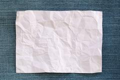 Note paper crumpled of empty and copy space on Denim background. Kuvituskuvat