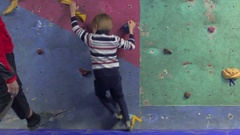 Child climber in training Stock Footage