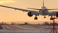 Golden hour airplane landing rear view Stock Footage