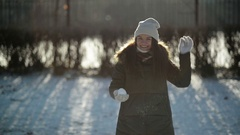 Happy Restless Young Girl is Throwing Snow at the Camera Having Fun Outdoors in Stock Footage