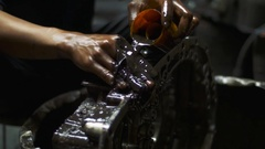 Dirty working hands in car repair shop garage Stock Footage