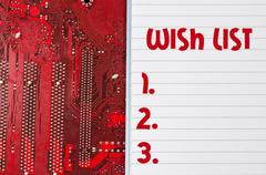 Red old dirty computer circuit board and wish list text concept Stock Photos