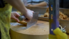 Close up of street vendor cutting chicken meat with a huge chef knife Stock Footage