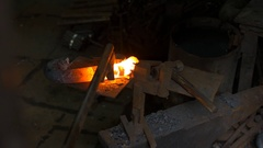 Blacksmith working with hot glowing metal, bending steel in a smithery Stock Footage