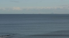 Gentle sea with ship in distance Stock Footage