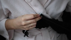 A woman in a housecoat engaged in knitting. Stock Footage