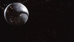 Disco mirrorball discoball spinning and reflecting light into a club venue Stock Footage