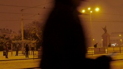 People waiting in a snow covered tram stop, Central Europe, Night Stock Footage