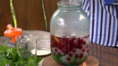 Preparation of Compote of Cherries in a Glass Jar at Home Stock Footage
