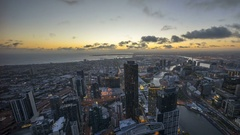 An aerial view of Melbourne cityscape. Timelapse during sunset day to night Stock Footage