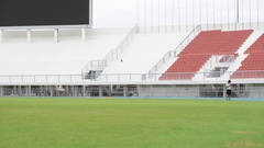 Boy play football in the ground Stock Footage