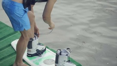 Man lace shoes on the lake Stock Footage
