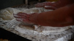 Woman rolls fancy pastry with rolling pin Stock Footage
