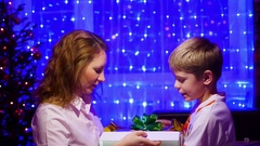 Christmas gift surprise - A kid and girl opens present with magic stars. In the Stock Footage