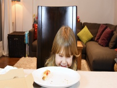Child devouring end of pizza at home Stock Footage