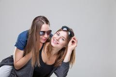 Studio portait of young twin sisters embracing Stock Photos