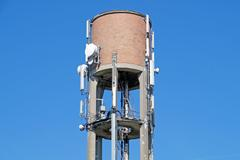 Antenna installed on top of water tower Stock Photos