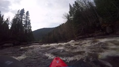 A man kayaks down a waterfall on a river. Stock Footage