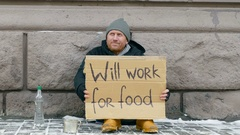 Funny and happy homeless man :) Sign on cardboard - will work for food. Stock Footage