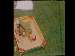 Kids in kiddie pool 1957 Overhead Stock Footage