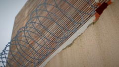 Barbed wire and razor wire fencing for protection against intruders. Stock Footage