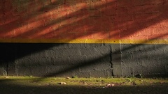 Protective wall Red, yellow, and black wall used against intruders. Stock Footage