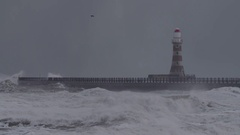 LIGHTHOUSE IN A STORM AT SEA - Slow motion Stock Footage