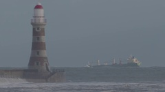 LIGHTHOUSE IN A STORM WITH SHIP Stock Footage