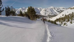 A young man snowboarding fresh power snow through trees in the mountains. Stock Footage