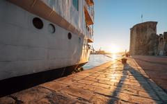 Sunset time on Adriatic sea in old harbor Stock Photos