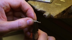 Jeweler set the diamond on a gold piece Stock Footage