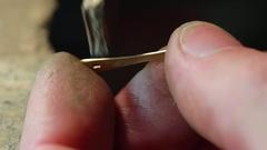 Jeweler polishing gold detail. close-up Stock Footage