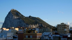 The Rock of Gibraltar and La Linea cityscape with clear blue sky in Spain Stock Footage