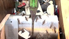 Recycling bin shredder waste crusher crushing bodyboard and wheels Stock Footage