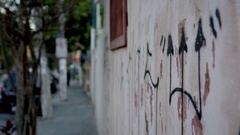 Vandalized property concrete wall Stock Footage