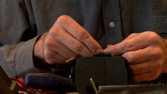 Repair electronics cable stripping Stock Footage