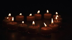 Tealight candles in a shape of a heart in slow motion Stock Footage
