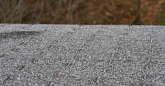 Panning Shot of Sleet Hitting a Home's Roof During an Ice Storm  	 Stock Footage