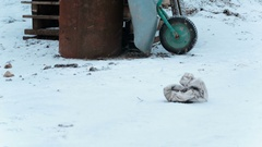 Cart rusty barrel and a stack of wooden pallets in the winter Stock Footage