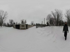 360Vr Video Man Between Fences of Houses Winter Snowy Cloudy Day Branch Trees Stock Footage