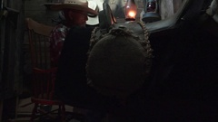 Cowboy Western, reading by gas lamp in bunkhouse Stock Footage