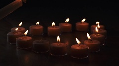 Tealight candles in a shape of a heart firing last in slow motion Stock Footage