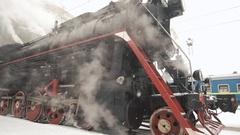 Old Retro Train Stops at the Station. Close up detail of wheels. Winter time Stock Footage