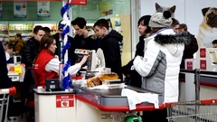 Many people on checkout counter in Auchan hypermarket Stock Footage