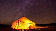 Timelapse of the Milky Way passing over a nomadic tent in the Sahara desert. Stock Footage