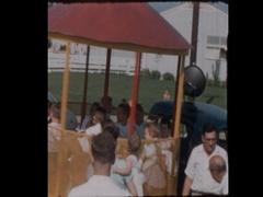 Neighborhood Kids Ride on Mobile Merry-Go-Round on suburban street Stock Footage