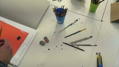 Man artist sorting out paintbrushes in jars Stock Footage