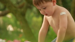 Unwrapping presents Clip of present being unwrap by infant toddlers Stock Footage