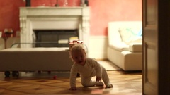 Baby toddler crawling on hardwood floor Cute adorable baby crawls. Stock Footage